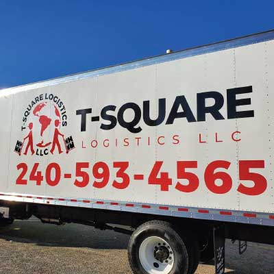 Black and red bock truck vinyl letters with phone number and logo. Text reads: T-Square Logistics LLC