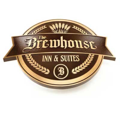 Brown and gold embossed cast metal plaqu with wheat border and logo. Text reads: The Brewhouse Inn & Suites