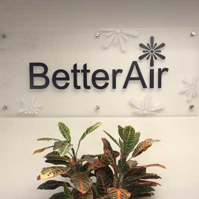 Frosted acrylic plastic sign with black lettering. Text reads: BetterAir