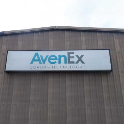 White with blue and grey log text lighted sign face. Text reads: AvenEx Coating Technologies