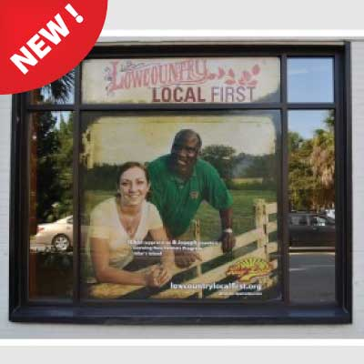 Vinyl picture of man and women leaning on a farm fence behind a glass business storefront