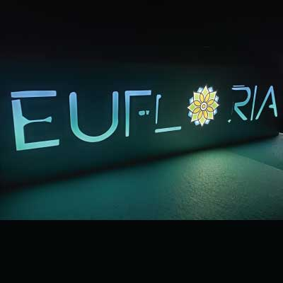 Glowing purple and blue slim-line indoor lighted sign. Text reads: Eufloria