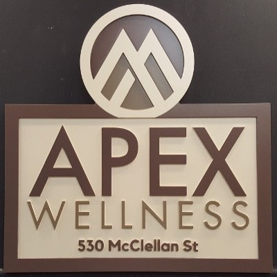Apex Wellness business's brown and white sign