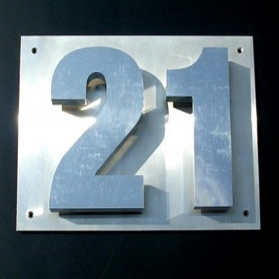 Brushed silver business sign in the shape of the number 21
