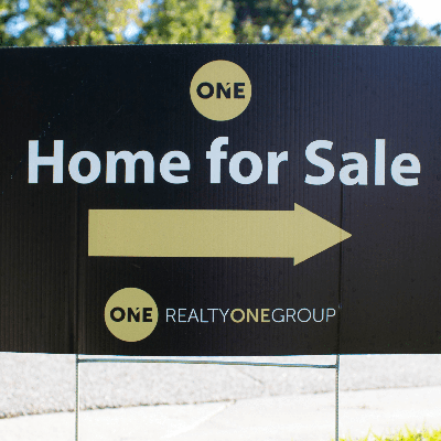 Coroplast yard sign for Realty One Group real estate business which reads Home For Sale