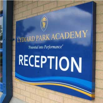 Lydyard Park Academy blue and yellow reception sign