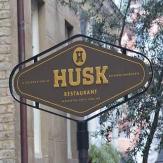 Husk Restaurant pole sign in Charleston