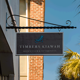 Timber's Kiawah Ocean Club & Residences hanging sign with engraved letters and beach chair logo