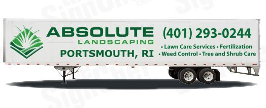 Side view of white 53 foot enclosed trailer with custom vinyl lettering & logos