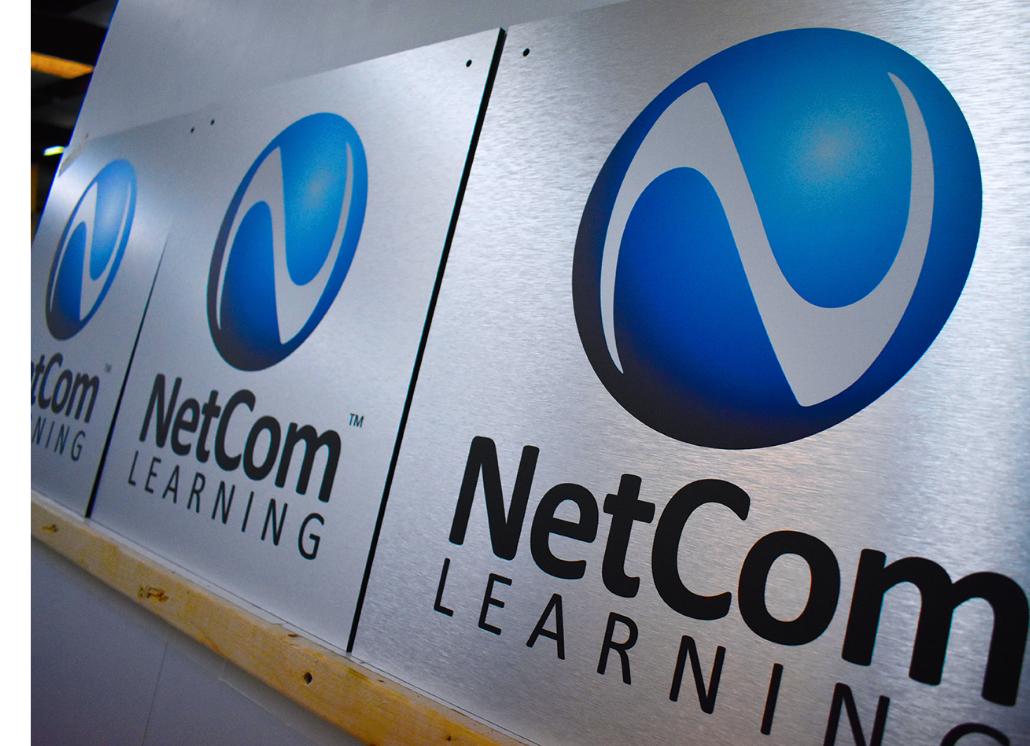Blue Printed Logo on Custom Aluminum Signage for NetCom Learning