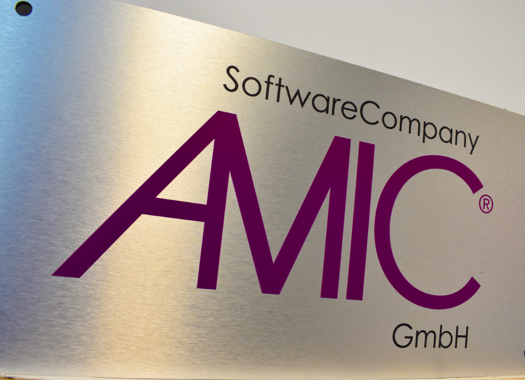 Brushed silver dibond wall sign with text that reads: SoftwareCompany AMIC GmbH