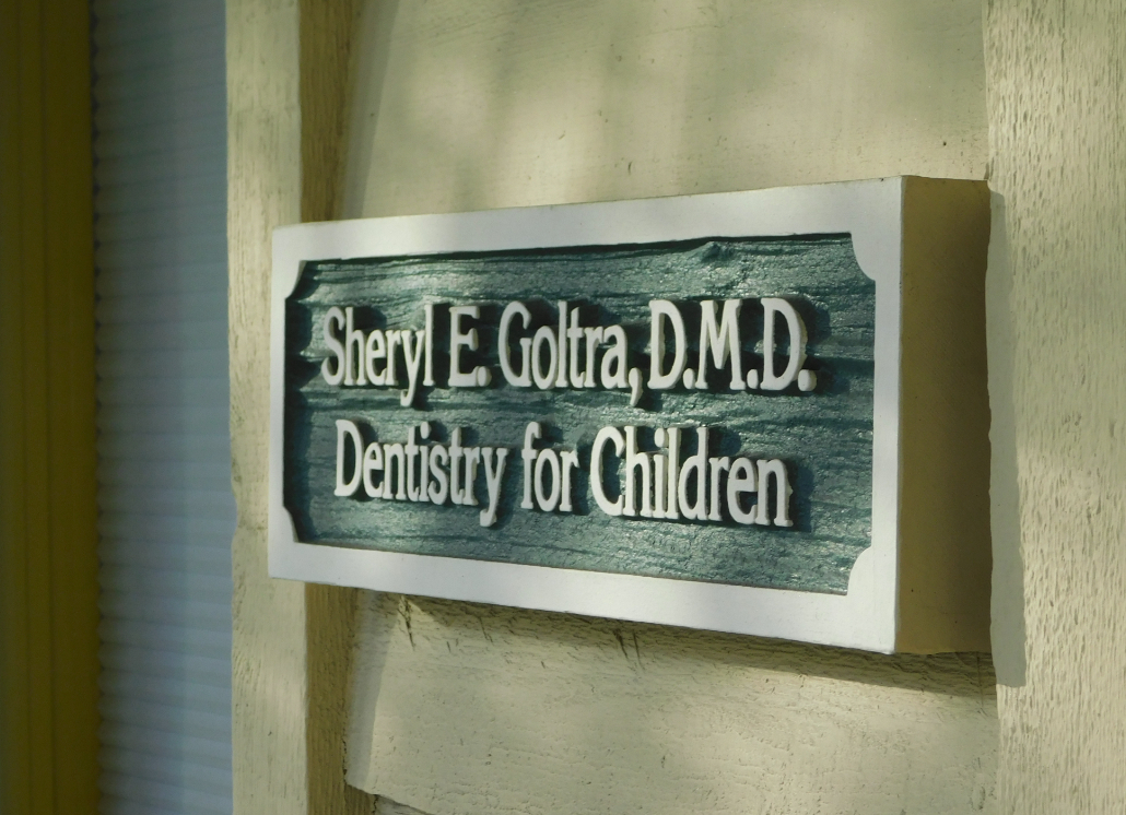 Sandblasted Dimensional Wooden sign with text that reads: Sheryl E. Goltra, D.M.D. Dentistry for Children