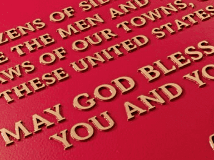 Cast Metal Plaque with text that reads: MAY GOD BLESS YOU