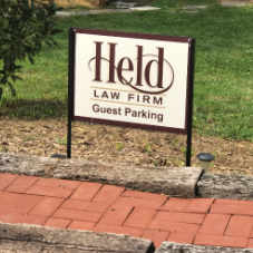 held law firm guest parking sign