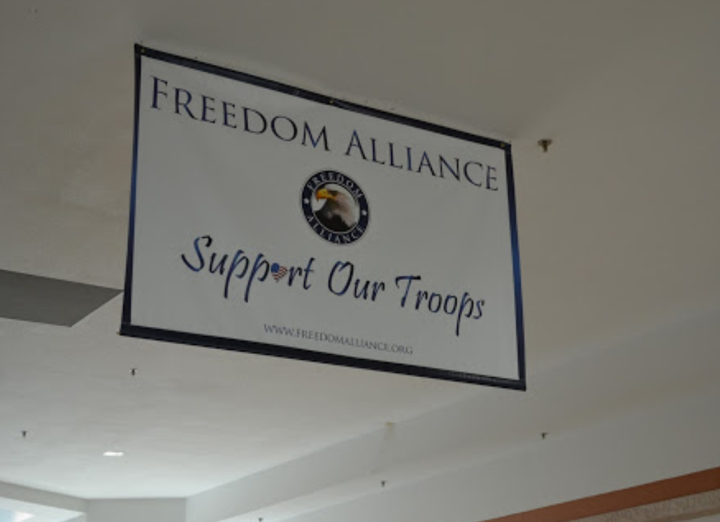 Indoor hanging sign with graphic of bald eagle and text that reads: FREEDOM ALLIANCE Support Our Troops