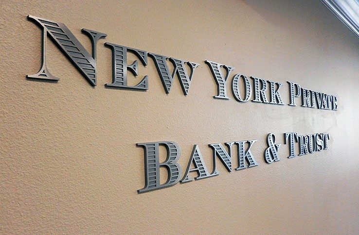 Brushed silver metal letters with text that reads: NEW YORK PRIVATE BANK & TRUST