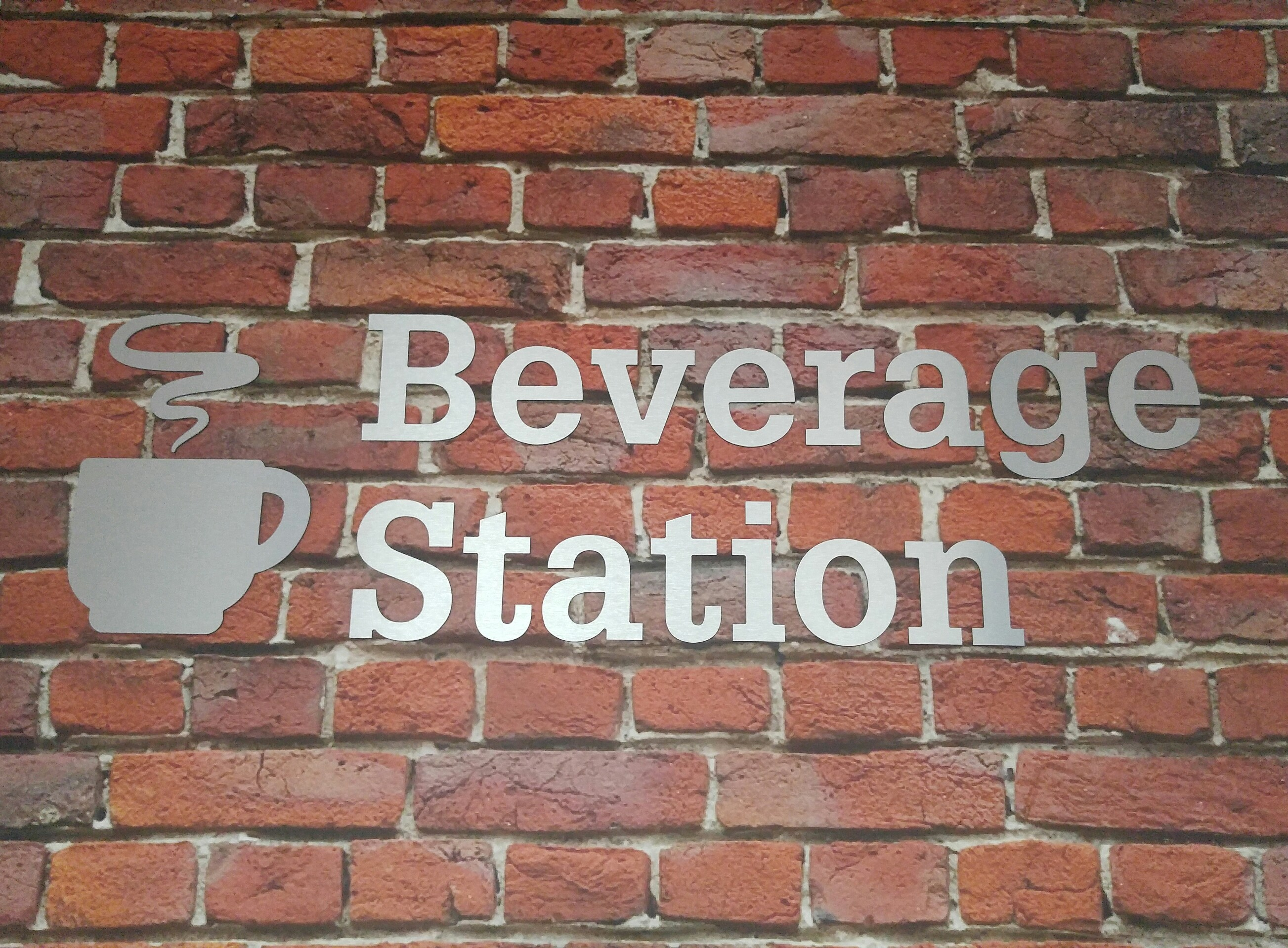 Brushed silver metal 3D letters with text that reads: Beverage Station