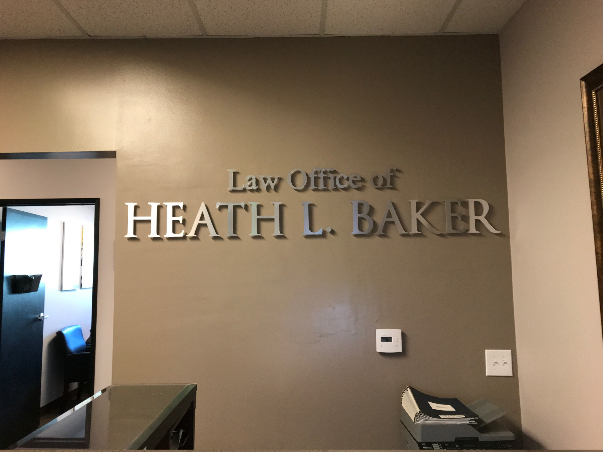 Brushed silver metal 3D letters with text that reads: Law Office of Heath L. Baker