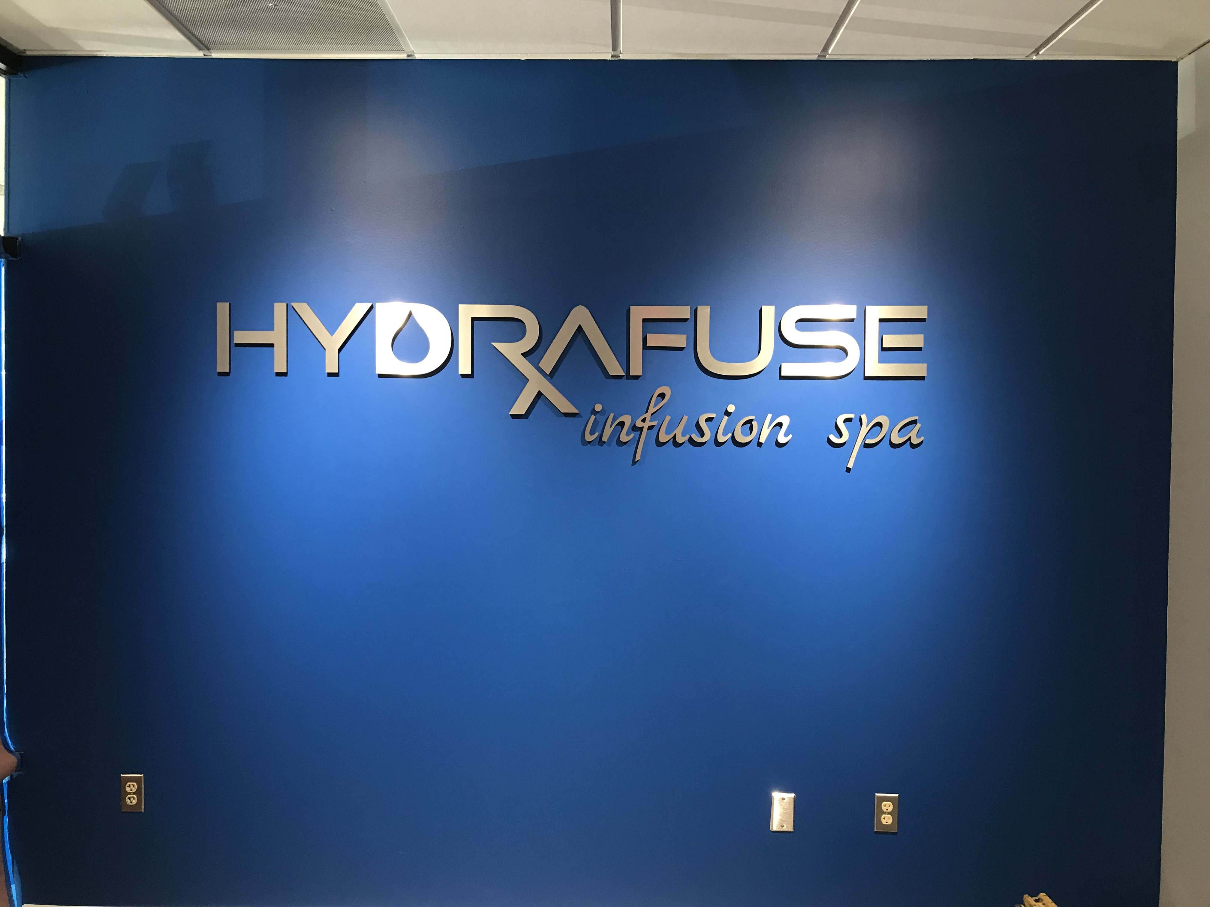 Metal-plated 3D Letters with text that reads: HYDRAFUSE infusion spa