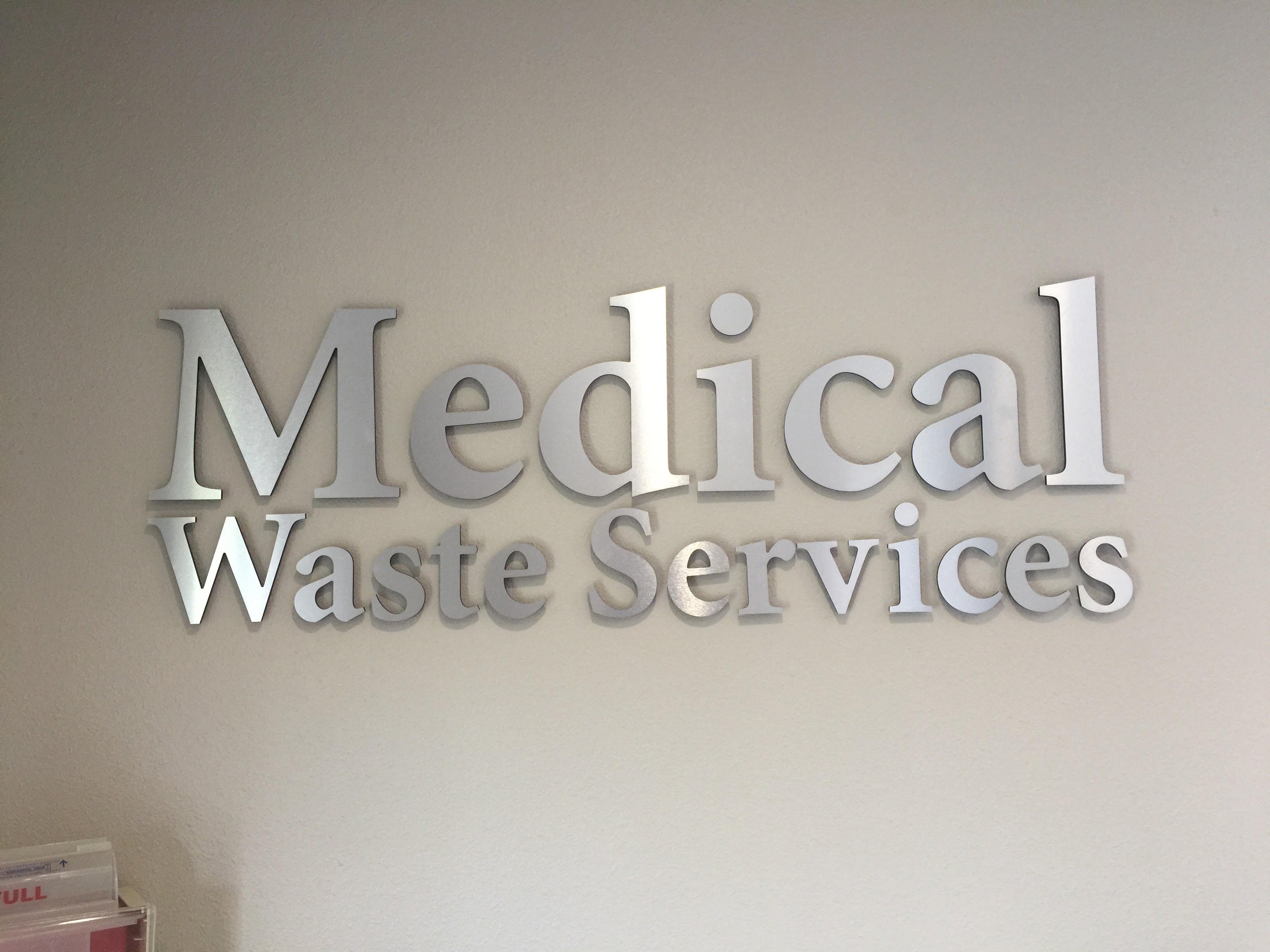 Brushed silver metal letters with text that reads: Medical Waste Services