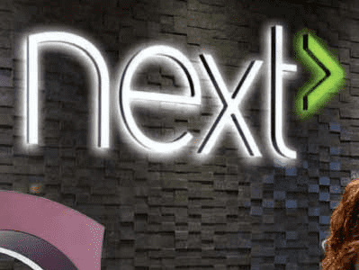 Illuminated channel letters with text that reads: next