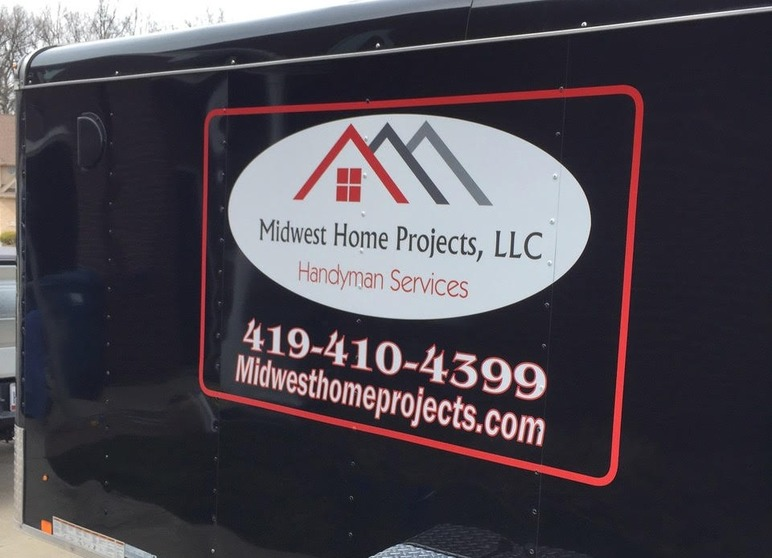 Midwest Home Projects LLC black and red trailer with graphics