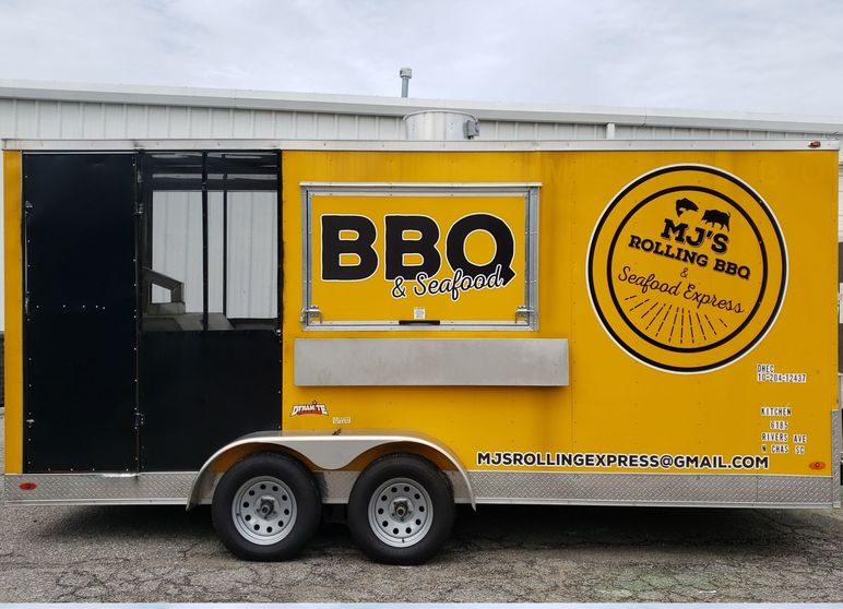 MJ's Rolling BBQ & Seafood Express black and yellow trailer with graphics