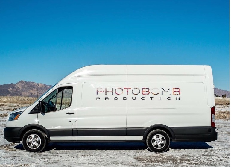 Photobomb van with graphic against mountainous background