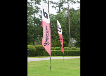 Two Ad Flags Mounted with Ground Stakes