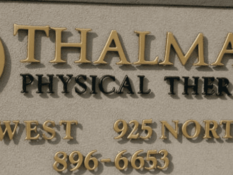Gold and Black Formed Plastic 3D Letters outdoors with text that reads: THALM PHYSICAL THER WEST