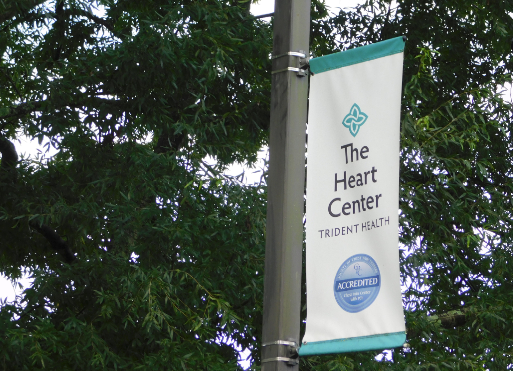 White pole banner with text that reads: The Heart Center TRIDENT HEALTH