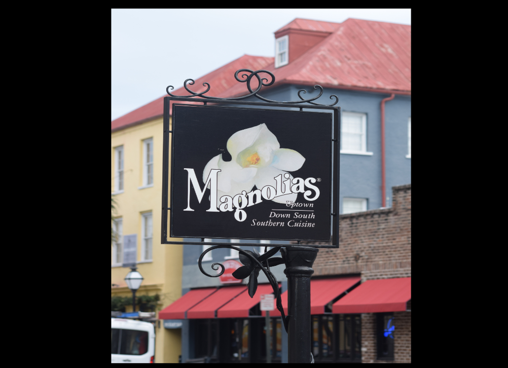 Magnolias Sign Mounted on Roadside Post