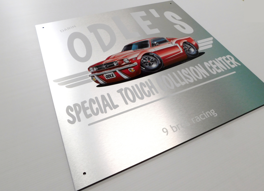 Brushed silver aluminum sign with Ford Mustang graphic and text that reads DARIN ODIE'S SPECIAL TOUCH COLLISION CENTER 9 bros racing