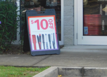 Sandwich Sidewalk Sign with Discount Pricing for Marketing