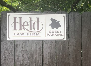 Held Law Firm Custom Fence Sign made of Alumalite Material
