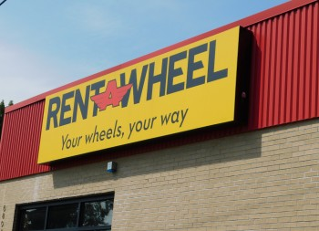 Rent A Wheel Business Signage with Replaceable Sign Face