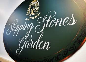 Stepping Stones Garden's Oval Shaped Copper Brushed Dibond Sign
