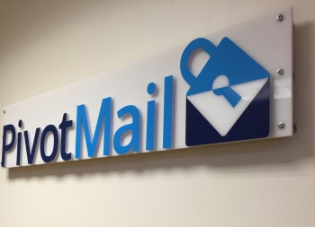 White Plastic Branded Signage for Pivot Mail