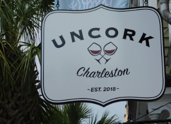 Uncork's Custom Wooden Hanging Sign with Wine Glass Design