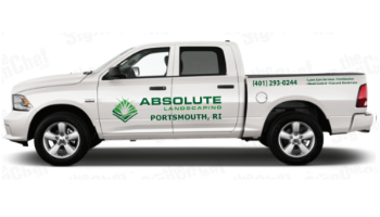 Side view of white crew cab Dodge Ram pickup truck short bed with vinyl graphics & logos