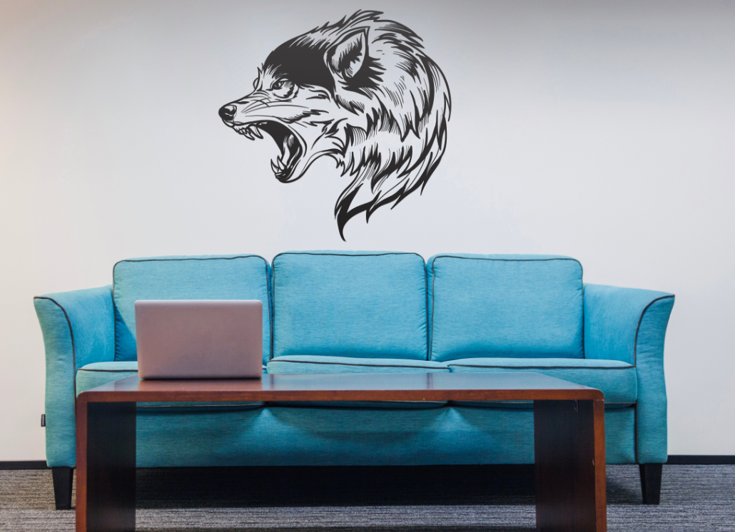 Gray wall graphic of wolf above blue couch
