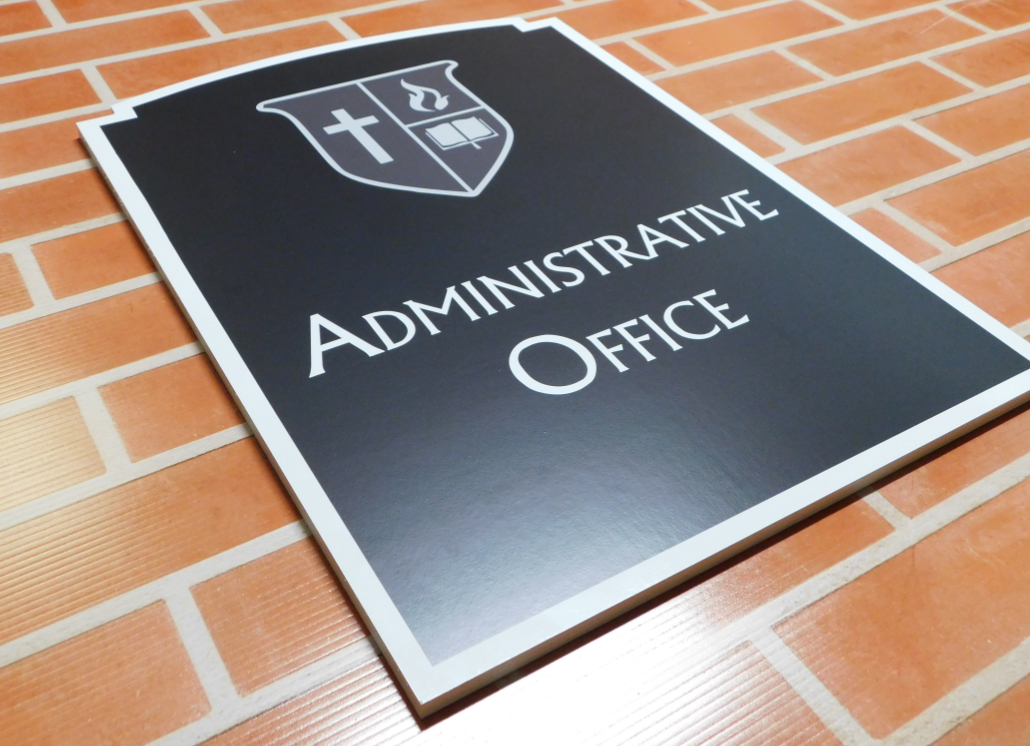 Black and white Dura-Wood wall sign with church logo and text that reads Administrative Office